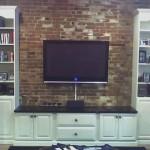 TV mounted on brick wall